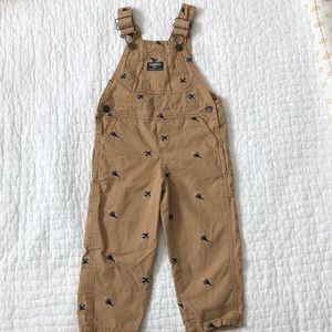 OshKosh tan overalls with jet plane embroidery, 2T